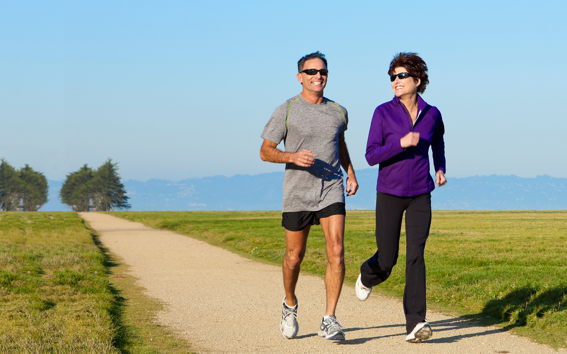 Man and woman running on a jogging path